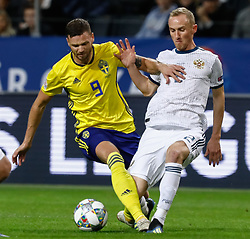 November 20, 2018 - Stockholm, Sweden - Marcus Berg (L) of Sweden and Vladislav Ignatyev of Russia vie for the ball during the UEFA Nations League B Group 2 match between Sweden and Russia on November 20, 2018 at Friends Arena in Stockholm, Sweden. (Credit Image: © Mike Kireev/NurPhoto via ZUMA Press)