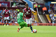 Jordan Amavi of Aston Villa breaks away from Sunderland's Yann M'Vila. Barclays Premier League match, Aston Villa v Sunderland at Villa Park in Birmingham, Midlands on Saturday 29th August  2015.<br /> pic by Andrew Orchard, Andrew Orchard sports photography.