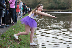 © Licensed to London News Pictures. 25/12/2017. Sutton Coldfield, Near Birmingham, UK. The traditional Christmas morning swim taking place at Blackroot Pool in Sutton Park earlier today. The free event attracts people who like to dress up in Christmas outfits and take the plunge into the open water, a different way to celebrate Christmas day. Pictured, Mollie Angers (10) turned up in her ballet outfit to take part. Photo credit: Dave Warren/LNP