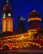 Sultan Abdul Samad Building illuminated at dusk, Kuala Lumpur, Malaysia.