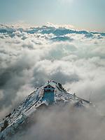 Aerial View of Grosse Mythen above the Clouds in Schwyz, Switzerland