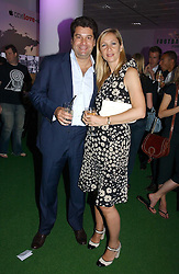 TANIA BRYER and her husband TIM MOUFFARIGE at a party to launch Umbro Football Fever at Selfridges, Oxford Street, London on 8th June 2006.<br />