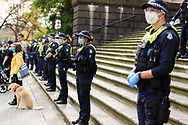 Police stand in large numbers in front of Parliament house during a Black Lives Mater rally on 06 June, 2020 in Melbourne, Australia. This event was organised to rally against aboriginal deaths in custody in Australia as well as in unity with protests across the United States following the killing of an unarmed black man George Floyd at the hands of a police officer in Minneapolis, Minnesota. (Photo by Dave Hewison/ Speed Media)