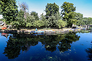 Trees and boats reflects in the River Lea in east London on Friday, Aug 7, 2020.<br /> The UK has seen its hottest day in August for 17 years, as temperatures reached more than 36C (96.8F) in south-east England, British press reports. Crowds of people headed to the coasts and rivers to enjoy the weather, but people have been urged to adhere to social distancing. (VXP Photo/ Vudi Xhymshiti)
