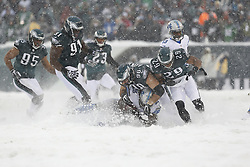 Philadelphia Eagles outside linebacker Connor Barwin #98 tackles Detroit Lions running back Joique Bell #35 during the NFL game between the Detroit Lions and the Philadelphia Eagles on Sunday, December 8th 2013 in Philadelphia. The Eagles won 34-20. (Photo by Brian Garfinkel)