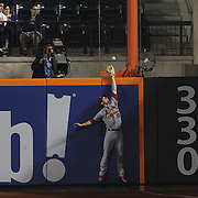 Right fielder Randal Grichuk, St. Louis Cardinals, can't stop a Daniel Murphy, New York Mets, two run home run as it just clears his glove during the New York Mets Vs St. Louis Cardinals MLB regular season baseball game at Citi Field, Queens, New York. USA. 19th May 2015. Photo Tim Clayton