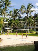 Children play volleyball at Daydream Island Resort; Whitsunday Islands, QLD, Australia