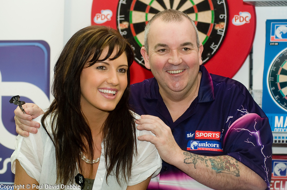 """Current Darts World Champion and leader of the Whyte & Mackay Premier League Darts tournament Phil """"The Power"""" Taylor appeared at JJB sports Meadowhall today (Friday 16 April 2010)  as part of a tour of selected JJB stores. The meadowhall appearance was the first in a series of 5 dates he is also due to be a JJB Sports stores in Liverpool on the 21st April, Bolton on the 7th June. Blackpool on the 26th July and Dublin on the 11th October 2010. The events include autograph opportunities and advice demonstration of the techniques that have made Phil a 15 times World Champion...Friday 16 April 2010. .Images © Paul David Drabble."""
