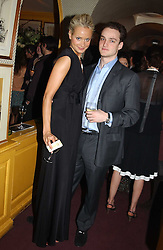 KALITA AL-SWAIDI and JAMES MAIZELS at a private dinner and presentation of Issa's Autumn-Winter 2005-2006 collection held at Annabel's, 44 Berkeley Square, London on 15th March 2005.<br /><br />NON EXCLUSIVE - WORLD RIGHTS