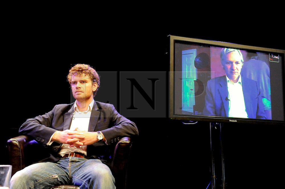 © licensed to London News Pictures. Brighton, UK. 21/05/2011. Dr Martin Morris and Julian Assange (via video link) at a debate about Freedom of Speech entitled Article 19 at the Brighton Festival 2011. Please see special instructions for licensing information. Photo credit should read: Peter Webb/LNP