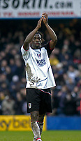 Photo. Glyn Thomas.<br /> Fulham v Southampton. FA Barclaycard Premiership. <br /> Loftus Road, London. 26/12/2003.<br /> Fulham's Louis Saha salutes the crowd after his two goals gave his side a 2-0 win over Southampton.