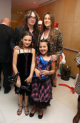 Musician JUSTIN HAWKINS and SUE WHITEHOUSE with her children left, FLORENCE and right CHARLOTTE at the English National Ballet's Mad Hatters Tea Party at St.Martins Lane Hotel, St Martins Lane, London on 12th December 2006.<br /><br />NON EXCLUSIVE - WORLD RIGHTS
