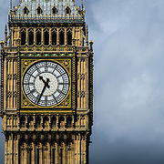 Big Ben Against Storm Clouds 169-093538572 The clock of Elizabeth Tower (commonly known as Big Ben) at Westminster Palace against dark, ominous storm clouds in the background. Includes copyspace.