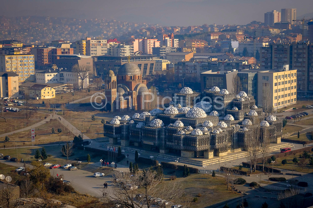 The Skyline of Pristina including the National Library of Kosovo 'PjetEr Bogdani' and the incomplete  Christ the Saviour Serbian Orthodox Cathedral, on the 13th of December 2018, Pristina, Kosovo.  Pristina is  the capital and largest city of Kosovo, it has a mainly Albanian population along with other smaller communities.