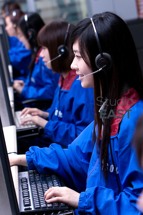GUANGZHOU, CHINA - May 26: Vivi Liang (long hair) answers clients' phone calls at Citigroup Data Processing Center on May 26, 2010 in Guangzhou, Guangdong province, China. (Photo by Lucas Schifres/Getty Images)