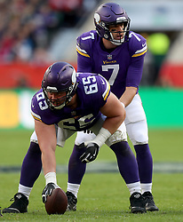 Minnesota Vikings' quarterback Case Keenum stands behind Minnesota Vikings' Pat Elflein before a snap during the International Series NFL match at Twickenham, London. PRESS ASSOCIATION Photo. Picture date: Sunday October 29, 2017. See PA story GRIDIRON London. Photo credit should read: Simon Cooper/PA Wire. RESTRICTIONS: News and Editorial use only. Commercial/Non-Editorial use requires prior written permission from the NFL. Digital use subject to reasonable number restriction and no video simulation of game.