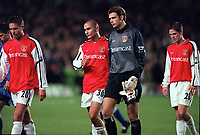 Dejected Arsenal players Paolo Vernazza, Matthew Upson, Stuart Taylor and Graham Barrett leave the pitch after the match. Arsenal 1:2 Ipswich Town, Worthington Cup, Third Round, 1/11/2000. Credit Colorsport / Stuart MacFarlane.