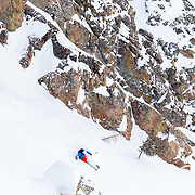 Tigger Knecht skis cowboy powder in the backcountry of Jackson, Wyoming.