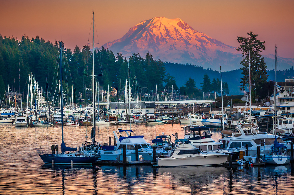"This photo was taken at sunset in the small town of Gig Harbor in Washington state. <br /> .....<br /> The equipment used was a Canon 5D Mk II with an EF 70-200/4L IS lens attached.<br /> .....<br /> Gig Harbor is the name of both a bay on Puget Sound and a city on its shore in Pierce County, Washington, United States. The population was 7,126 at the 2010 census.<br /> .....<br /> Gig Harbor is one of several cities and towns that claim to be ""the gateway to the Olympic Peninsula"". Due to its close access to several state and city parks, and historic waterfront that includes boutiques and fine dining, it has become a popular tourist destination. Gig Harbor is located along State Route 16, about six miles (10 km) from its origin at Interstate 5, over the Tacoma Narrows Bridge. A 1.2 billion dollar project to add a second span to the bridge was recently completed. During off-peak traffic times, Tacoma can be reached in five minutes and Seattle in just under an hour. Based on per capita income, Gig Harbor ranks 49th of 522 areas in the state of Washington to be ranked.<br /> .....<br /> History<br /> During a heavy storm in 1840, Captain Charles Wilkes brought the Captain's gig (small boat) into the harbor for protection. Later, with the publication of Wilkes 1841 Map of the Oregon Territory, he named the sheltered bay Gig Harbor. 1867 brought fisherman Samuel Jerisich to the Gig Harbor area, along with many other immigrants from Sweden, Norway, and Croatia. The town was platted in 1888 by Alfred M. Burnham."