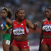 Lauryn Williams, USA, (centre) and Bianca Knight, USA, (right) in action in the Women's 4 X 100m Heats at the Olympic Stadium, Olympic Park, during the London 2012 Olympic games. London, UK. 9th August 2012. Photo Tim Clayton
