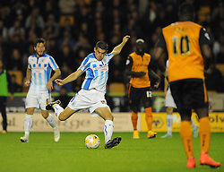 Huddersfield Town's Conor Coady scores his sides third goal to make it 0 - 3 - Photo mandatory by-line: Dougie Allward/JMP - Mobile: 07966 386802 - 01/10/2014 - SPORT - Football - Wolverhampton - Molineux Stadium - Wolverhampton Wonderers v Huddersfield Town - Sky Bet Championship