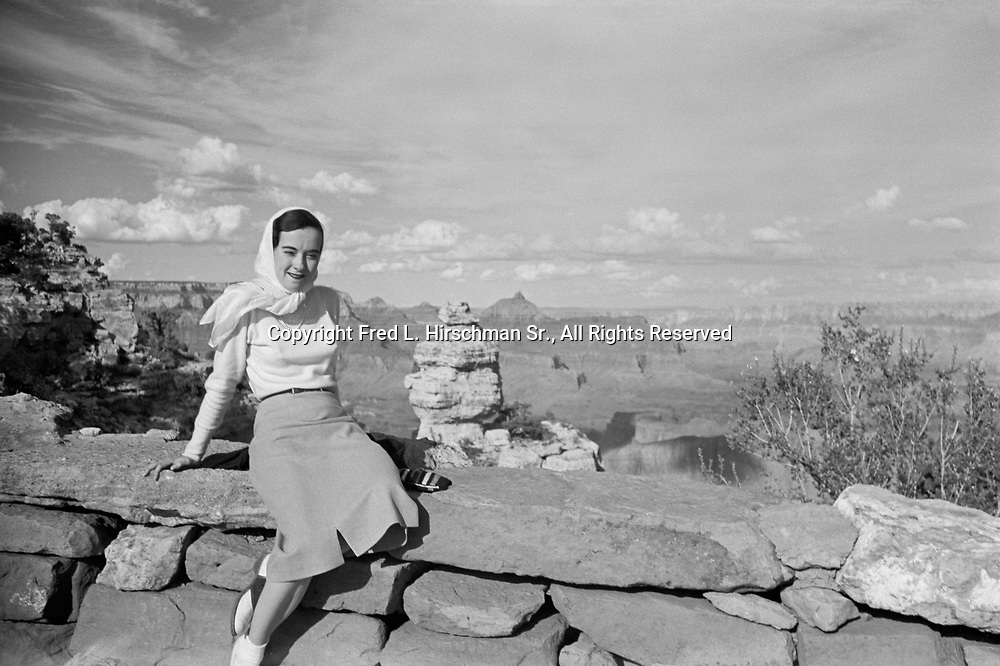 Octavia Hirschman sitting on overlook at Duck on a Rock, South Rim of the Grand Canyon, Grand Canyon National Park, Arizona, September, 1949.