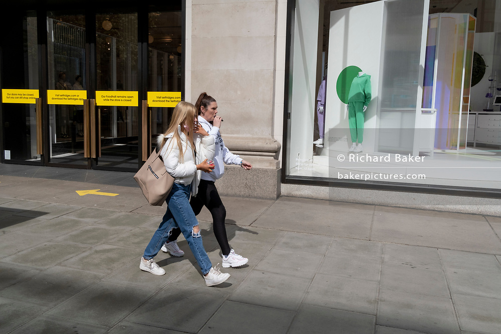 Days before the third Coronavirus lockdown ends, and non-essential retailers and shops re-open again, shoppers walk past the Selfridges department store on Oxford Street, on 9th April 2021, in London, England.
