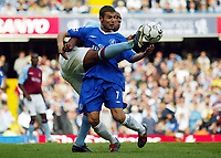 Photograph: Scott Heavey, Digitalsport<br /> Chelsea v Aston Villa. FA BArclaycard Premiership. 27/09/2003.<br /> Adrian Mutu in a tangle with Dion Dublin