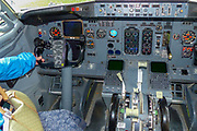 Interior of a cockpit with flight control gauges and controls