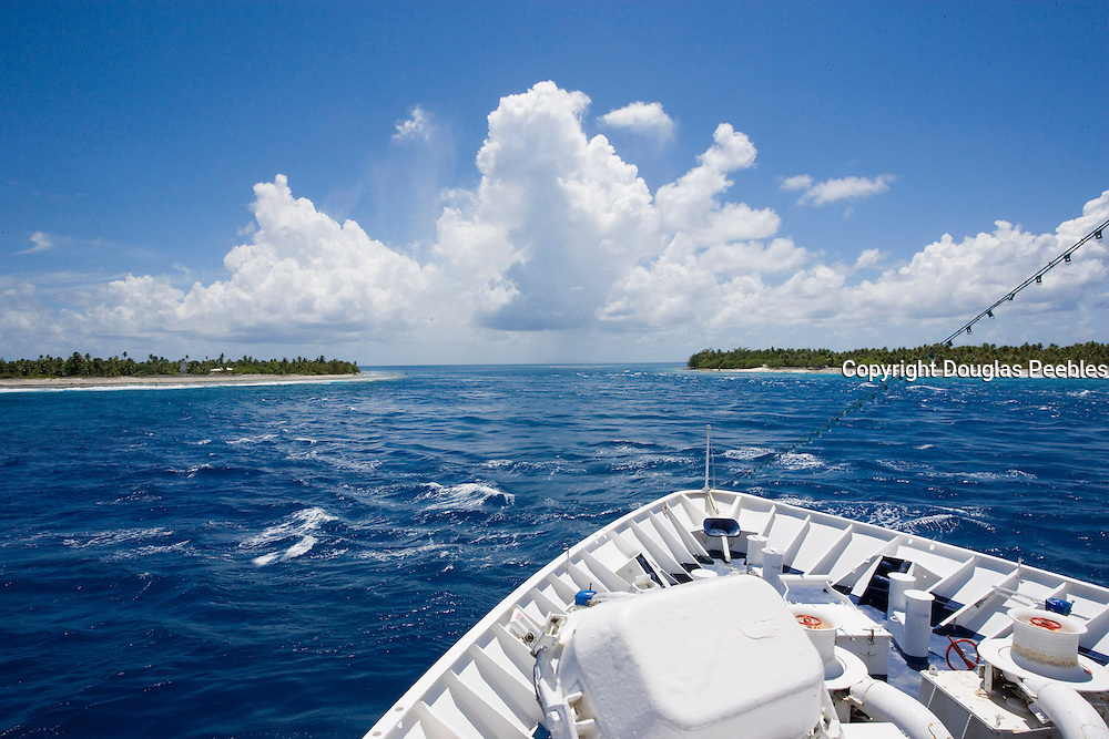 Cruise ship entering Tiputa Pass, Rangiroa, Tuamotu Islands, French Polynesia<br />