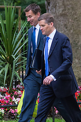 Downing Street, London, June 16th 2015. Health Secretary Jeremy Hunt (L) and Chief Whip Mark Harper,  arrives at 10 Downing Street for the weekly cabinet meeting.