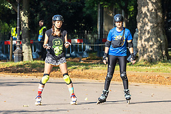 Licensed to London News Pictures. 16/09/2021. London, UK. Rollerbladers enjoys the late summer sun in Hyde Park, London as weather forcasters predict a warmer few days ahead with highs of 24c for London and the South East. Photo credit: Alex Lentati/LNP