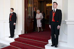 Queen Elizabeth II arrives to bid farewell to Colombia's President Juan Manuel Santos and his wife Maria Clemencia de Santos at Buckingham Palace in London.