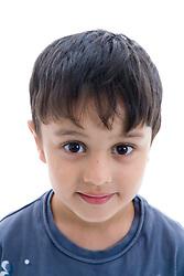 Portrait of a little boy smiling in the studio,