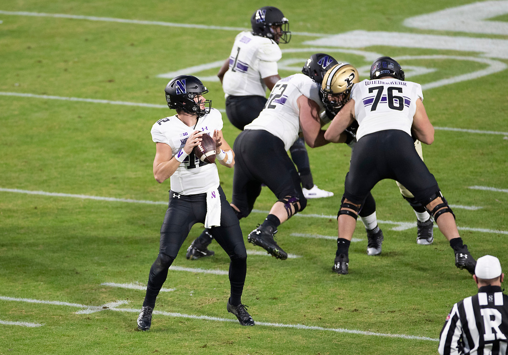 November 14, 2020:  Northwestern quarterback Peyton Ramsey (12) passes the ball during NCAA football game action between the Northwestern Wildcats and the Purdue Boilermakers at Ross-Ade Stadium in West Lafayette, Indiana. Northwestern defeated Purdue 27-20.  John Mersits/CSM.