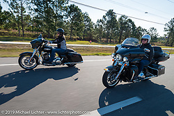 Shelly and Mandy Rossmeyer riding from the Harley-Davidson Speedway display to Destination Daytona Harley-Davidson for the Women's MDA Ride before leaving the Harley-Davidson display for Destination Daytona during Daytona Bike Week. FL, USA. March 11, 2014.  Photography ©2014 Michael Lichter.