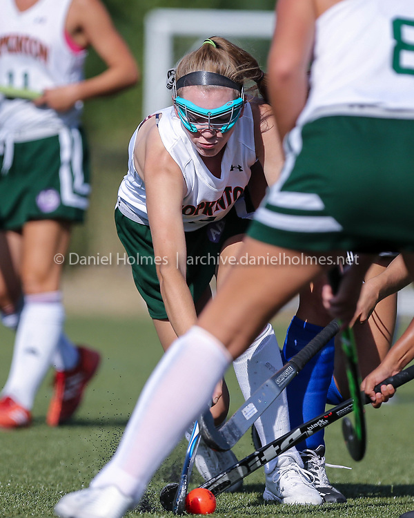 (9/4/18, HOPKINTON, MA) Hopkinton's Cami McDonald breaks through the defense during the field hockey game against Ashland at Fruit Street fields in Hopkinton on Tuesday. [Daily News and Wicked Local Photo/Dan Holmes]