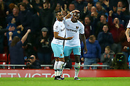 Michail Antonio of West Ham United (r) celebrates with teammate Dimitri Payet (l) after scoring his teams 2nd goal. Premier League match, Liverpool v West Ham Utd at the Anfield stadium in Liverpool, Merseyside on Sunday 11th December 2016.<br /> pic by Chris Stading, Andrew Orchard sports photography.