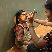Ramani treating a partially blind girl at the new Physiotherapy Unit at APD. According to APD, the physiotherapy practiced tries to reach people through grass-root staff and is a therapy that is easy to adapt and avoids complicated methods.