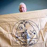 041213       Cable Hoover<br /> <br /> Local historian Martin Link displays a City of Gallup flag that he says was designed by Sally Noe for the city's centennial in 1981.