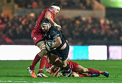 Ospreys' Scott Baldwin is tackled by Scarlets' Aaron Shingler - Mandatory by-line: Craig Thomas/Replay images - 26/12/2017 - RUGBY - Parc y Scarlets - Llanelli, Wales - Scarlets v Ospreys - Guinness Pro 14