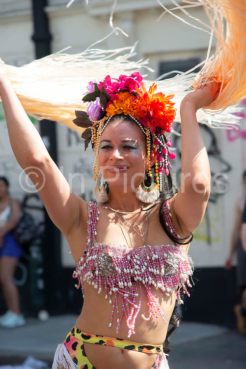 Party goer at the Notting Hill Carnival, on 25th August, 2019 in London, United Kingdom. One million people are expected on the streets in scorching temperatures for the Notting Hill Carnival, Europes largest street party and a celebration of Caribbean traditions.