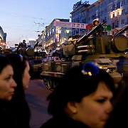 Russians watch a rehearsal of military parade for the Victory Day on May 9th in Moscow to show off Russia's arsenal and commemorate the Second World War.