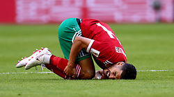 Morocco's Mbark Boussoufa goes down injured