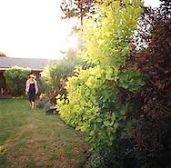 a woman walking through the garden
