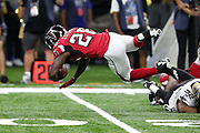 Atlanta Falcons running back Tevin Coleman (26) dives over a defender as he catches a late second quarter pass for a gain of 6 yards during the 2016 NFL week 3 regular season football game against the New Orleans Saints on Monday, Sept. 26, 2016 in New Orleans. The Falcons won the game 45-32. (©Paul Anthony Spinelli)