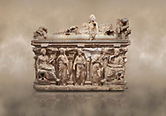 """Roman relief sculpted sarcophagus of Domitias Julianus and Domita Philiska depicted reclining on the lid, 2nd century AD, Perge. Antalya Archaeology Museum, Turkey.<br /> <br /> it is from the group of tombs classified as. """"Columned Sarcophagi of Asia Minor"""". <br /> The lid of the sarcophagus is sculpted into the form of a """"Kline"""" style Roman couch on which lie Julianus &  Philiska. This type of Sarcophagus is also known as a Sydemara Type of Tomb.. Against a warm art background.<br /> <br /> If you prefer to buy from our ALAMY STOCK LIBRARY page at https://www.alamy.com/portfolio/paul-williams-funkystock/greco-roman-sculptures.html . Type -    Antalya    - into LOWER SEARCH WITHIN GALLERY box - Refine search by adding a subject, place, background colour, etc.<br /> <br /> Visit our ROMAN WORLD PHOTO COLLECTIONS for more photos to download or buy as wall art prints https://funkystock.photoshelter.com/gallery-collection/The-Romans-Art-Artefacts-Antiquities-Historic-Sites-Pictures-Images/C0000r2uLJJo9_s0"""
