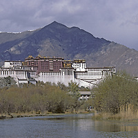 CHINA, TIBET, LHASA. Potala Palace, former abode of Dalai Lama & site of many Tibetan Buddhist temples. Photo from 1986, before explosive city growth and Chinese construction of new buildings.
