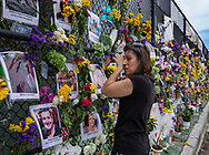Gini Gonte visits the Surfside Wall of Hope & Memorial on Wednesday, July 7, 2021, as she honors her friends Nancy Kress Levin and Jay Kleiman, who lost their lives after the collapse of the Champlain Towers South in Surfside, Florida.
