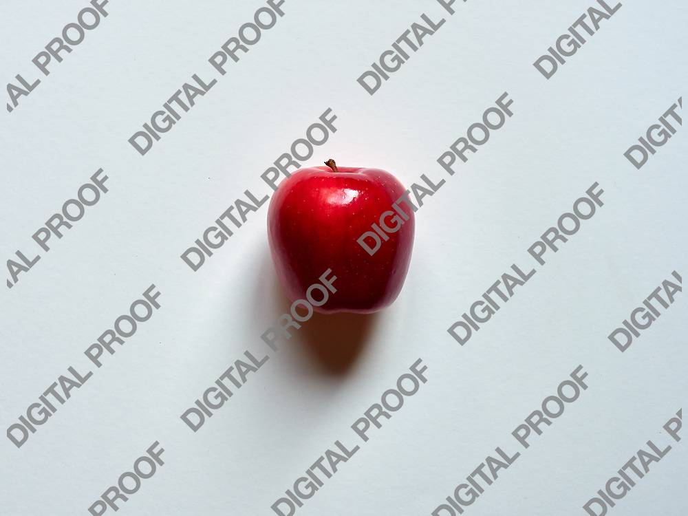 Red apple viewed from above over a white background isolated in studio